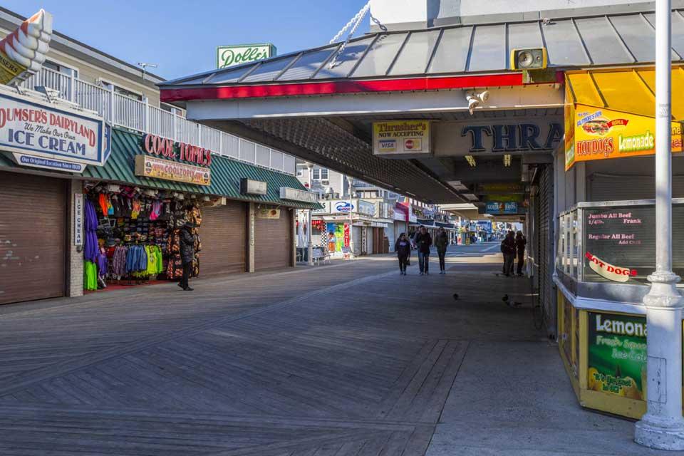 People walking on boardwalk in Ocean City, MD
